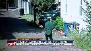 Man with gun steals car
