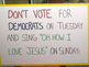 Pastor places sign outside of polling location