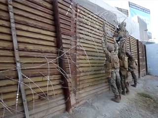Troops reinforce U.S.-Mexico border wall