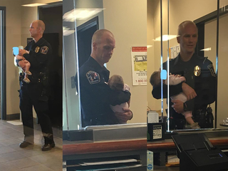 Officer holds baby as mother files report